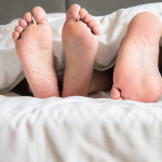 The couple's feet in the quilt