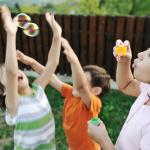 bigstock-Happy-children-playing-with-bu-15443921