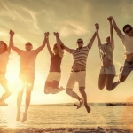 Happy-friends-jumping-on-a-beach-800x450