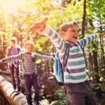 kids-walking-on-log-in-forest