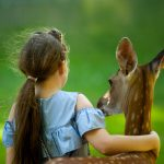 Canva-Girl-Wearing-Blue-Top-With-her-hand-around-a-deer--scaled