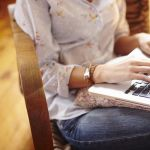 young-woman-at-home-working-on-laptop-476850553-57a13c545f9b589aa922804e
